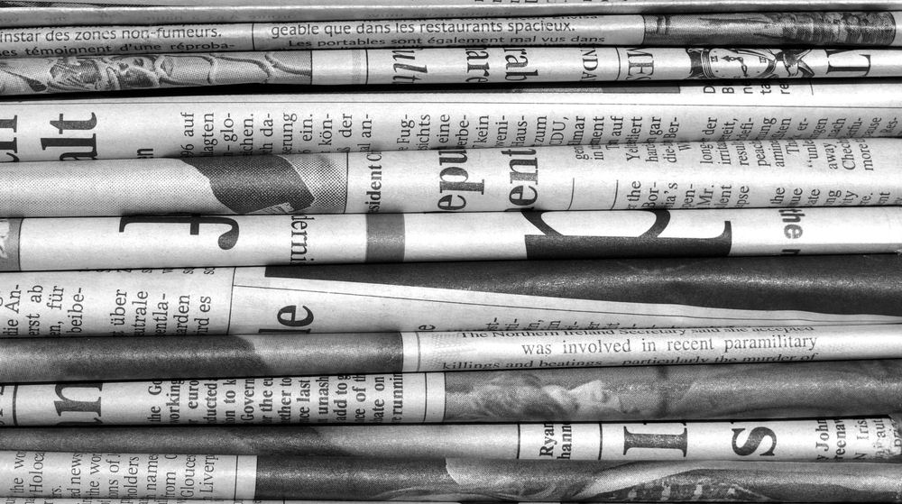 stack-of-newspapers copy